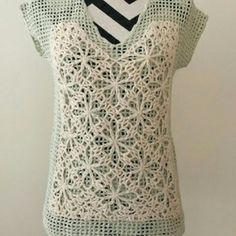 Anthropologie Crochet Top Field of Flowers brand for Anthropologie. Floral crochet short sleeve top with tie back in netted material..EUC no damage Anthropologie Tops