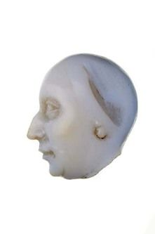 An agate cameo head of a woman. This is part of a commesso cameo portrait (made up from pieces of different gemstones). Part of the Cheapside Hoard.  Production Date: late 16th-early 17th century