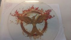 My complete version of the mockingjay, hand painted on glass.