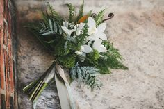 Lush bridal bouquet with a few white orchids, fiddlehead ferns, and a variety of foliage - Truly You Events, Love Me Do | Snippet & Ink