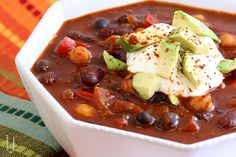THREE BEAN CHILI  Don't let the 12 cloves of garlic or the cocoa powder, or cinnamon sway you.
