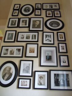 Beautiful picture wall--this is exactly what I want to do, black frames with old photos