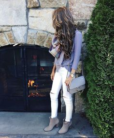 White jeans, blue shirt, gray ankle boots.