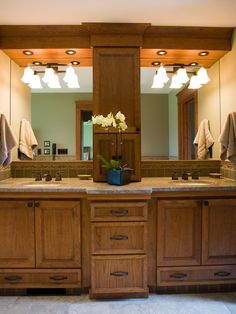 This master bathroom has a custom-designed his-and-hers vanity with a granite countertop, giving this spacious bathroom more storage.