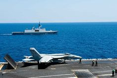 French Marine Nationale La Fayette-class frigate FS Guepratte (F 714) conducts a passing exercise with the aircraft carrier USS John C. Stennis (CVN 74) while an F/A-18E Super Hornet assigned to the Vigilantes of Strike Fighter Squadron (VFA) 151 prepares to launch from the flight deck during routine flight operations.