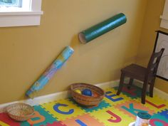 DIY Ball Ramp. Hot tip: Use velcro to attach it to the wall! Why didn't I think of that?