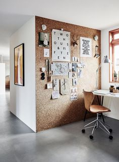 A floor-to-ceiling cork board installation invites a versatile element to the decor, not to mention a rather crafty approach to organization.