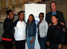 Former Celtics Star Dave Cowens with a few members of the Fisher College Women's Basketball Team.  - Fisher College -