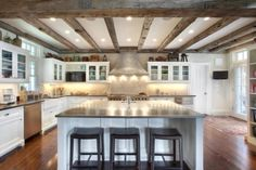 black soapstone counters.  sink. Beams! white cabinets. stove focal point.