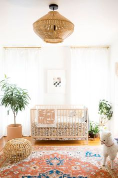 Beautiful Nursery with wicker light fixture and gorgeous traditional carpet