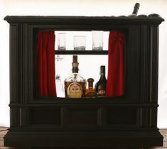 Recycled Console TV to Bar  credit: Alpine Butterfly [http://alpinebutterfly.blogspot.com/2008/01/recycled-tv-bar.html]