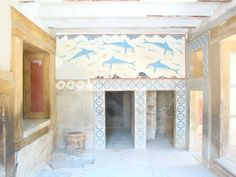 Beautiful dolphins in the Queen's Hall - Knossos (Κνωσσός). Knossos palace is an impressive construction dated to the golden age of Minoan civilization. Probably, the palace had 3 floors. It is interesting that there were columns that tapered downwards, as well as so-called 'light wells' (apertures in the ceiling leading through all the floors of the construction) that were used for ventilation of premises and instead of windows. There was a full-fledged sewerage in Knossos!