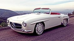 This, dear folks, is the Mercedes-Bent 190SL. Hot Rods and Custom Stuff gutted a 1961 Mercedes 190SL, then widened and lengthened the body to drop nicely on top of a 2004 Mercedes SL600 drive train sporting the 6.0L twin turbo 36 valve V-12 SOHC power plant. Then RENNTECH got a hold of it... the result is a beautiful white beast that runs 650 hp at 5500 rpm and 785 lb-ft of torque at 2000 rpm with digital ride height & locking slip differential.  ~ Show Stopper ~ dream-garage