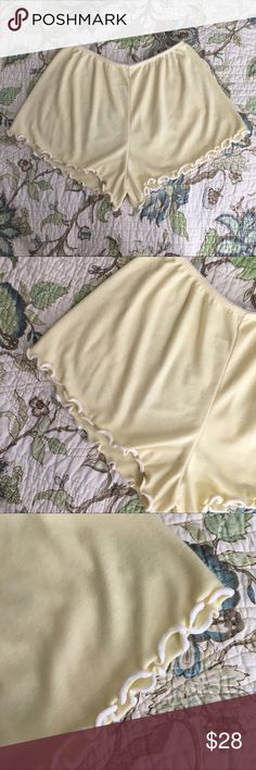 Vintage 90s yellow sleep shorts Vintage 90s yellow sleep shorts. Pastel yellow high waisted lingerie shorts. High cut at the hips. Elastic waist, very stretchy. Material is sheer and has a little bit of stretch. Has curly edge trim around the legs. Measurements are taken laying flat: waist: length: ((color of material is different in person, my phone camera wasn't able to capture the true color.)) Vintage Intimates & Sleepwear Pajamas