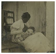 """Just look at this mom. She is not nearly concerned enough about what I think about her feeding her baby."" Front Porch - 1898 