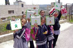 UNRWA and OLPC have been working together in Gaza and the West Bank to implement community laptop programs this year. In many schools in such as this one in Ramallah, students use their XOs in class and out. These girls are on their way home.