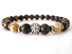 Masculine men's bracelet featuring 8mm tiger iron beads, 8mm picture jasper beads and pewter accent beads. The tiger iron beads have rich chocolate and dark brown tones highlighted with stunning golden-yellow streaks making this quite the handsome bracelet!