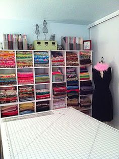 Buttons, Bows & Bling: Fabric Organization. These shelves, with baskets for yarn interspersed with the folded fabric in there too, would be so great in a craft room.