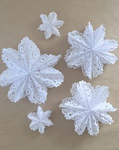 The idea for these beautiful, lacy snowflake stars came from the paperbag stars we made last summer. SITS Girls had the original idea and made them out of w