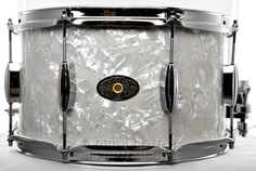 Montineri Custom Vintage Mahogany Snare Drum 8x14 White Marine Pearl  8x14 vintage mahogany shell w/ maple reinforcement rings in vintage white marine pearl, beavertail lugs, Trick Strainer.  Purchase Here: http://www.drumcenternh.com/drums/snare-drums/montineri-custom-vintage-mahogany-snare-drum-8x14-white-marine-pearl.html