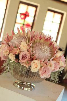 Protea is one of the latest trends in so have a look at the ideas to make your wedding super trendy! Protea bouquets are awesome and very original – just take one or several flowers. Protea Centerpiece, Floral Centerpieces, Wedding Centerpieces, Wedding Table, Wedding Decorations, Wedding Ideas, Big Flowers, Bridal Flowers, Pretty Flowers