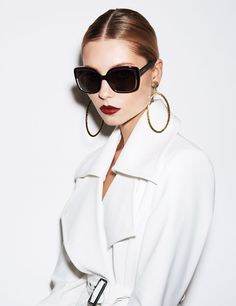 I love the contrast between the white coat and black glasses. www.missKrizia.com