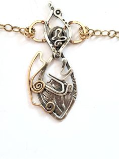 """This Aquatic Soul, limited edition piece is completely handmade and unique. The necklace is made of sterling silver and rose gold fill. On a brushed 14kt/20 yellow gold cut cable chain from 17.5"""" to 20"""".  The fish pendant is 1 and 15/16 inches long Cut Cable, Makers Mark, Initials, Fill, Rose Gold, Necklaces, Sterling Silver, Chain, Yellow"""