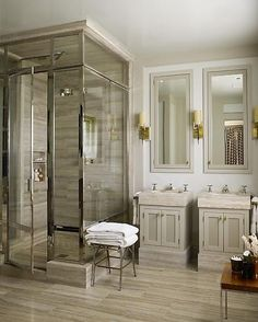 Live in luxury with an elegant bathroom design and dual sinks. www.remodelworks.com