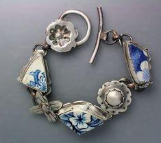 Bracelet | Temi Kucinski.  Pottery shards found along the shore of Lake Erie and sterling silver.