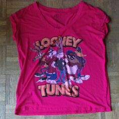 Looney tunes t-shirt Looney tunes T-shirt only worn once didn't fit how I wanted. Red shirt with Looney tunes characters on front.  Over sized T-shirt is a small but will fit medium. Got it at forever21 not very long ago but never got around to returning it. Perfect condition has always been hung up and always been in a smoke free home. Forever 21 Tops Tees - Short Sleeve