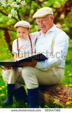 Stock Images similar to ID 219081673 - grandfather reading book with...