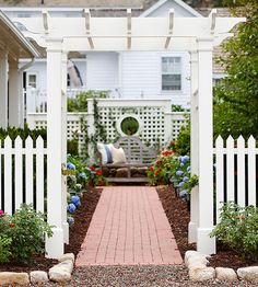 Outdoor Life An inviting arbor and picket fence around the garden to frame the backyard space.