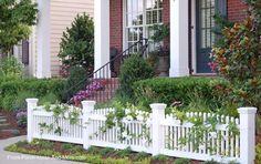 Flowering vines wind along a #picketfence for added appeal of #porch: front-porch-ideas-and-more.com