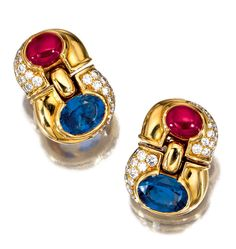 PAIR OF SAPPHIRE, RUBY AND DIAMOND EARRINGS, BULGARI.  Each articulated earring collet-set with a cabochon ruby and an oval sapphire, further decorated with brilliant-cut diamonds, mounted in yellow gold,  signed Bulgari, Italian assay marks.