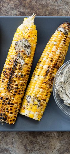 Husk-Grilled Corn: Moist, smoky, and deeply flavorful. A simple flavored butter seasons the corn before it is returned to the grill to lightly caramelize.
