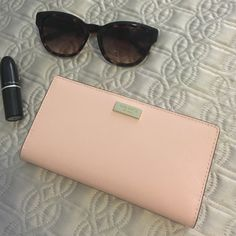 Kate Spade Pink Stacy Wallet Newbury Lane Beautiful Kate Spade Stacy wallet in the gorgeous posypink color.  Durable crosshatched leather and gold toned hardware. Would make a great gift. NWT and care card.  Reasonable offers welcomed. kate spade Bags Wallets