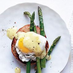 Eggs Benedict -- We cut this buttery breakfast classic down to size so you'll feel guilt-free as you eat in bed.
