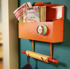 """Keep kitchen essentials out of the way, yet accessible, with this easy DIY kitchen mailbox organizer. Store cookbooks, coupons, potholders and aprons. 