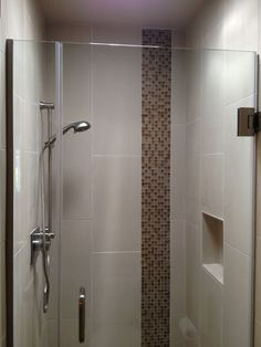 Delta shower fixtures and Ann Sacks accent tile