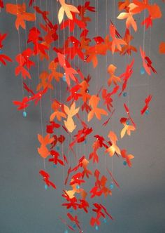 ♥ mobiles, this looks amazing but I wonder if they'd get very badly tangled if they're paper?