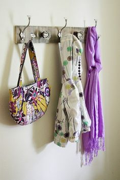 pallet coat rack! diy. The alternating hooks and knobs are really cute!