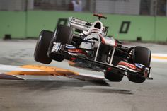 23 September 2011: Kamui #Kobayashi of Sauber F1 Team loses control of his car at a chicane during the free pactice session of the Singtel Singapore Grand Prix held at Marina Bay Street Circuit, Singapore #singapore #grand_prix #grandprix #f1 #formula1 #sauber
