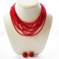 Original beaded 1950s vintage jewellery set from the fifties of a red multi strand necklace and matching earrings This three piece set is very red