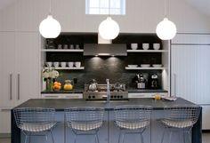 White dishes against a black marble backsplash