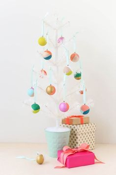 DIY Mod Wooden Ornaments One of my favorite ways to celebrate at Christmas is making new ornaments for the tree, like these painted wooden . Noel Christmas, Modern Christmas, Diy Christmas Ornaments, All Things Christmas, Holiday Crafts, Holiday Fun, Christmas Decorations, Tree Decorations, Minimalist Christmas