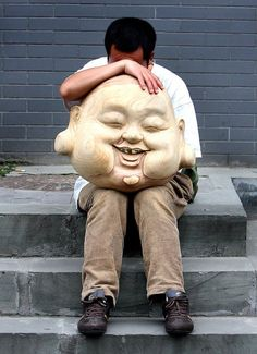 A street vendor in Xi'an rests on a stoop. (Photo by Mark Edelson/The Palm Beach Post)