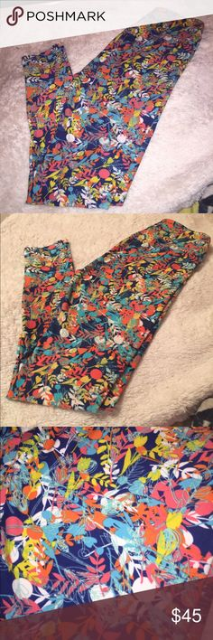 LuLaRoe Leggings OS Brand new with out tags. Navy background with multicolor floral pattern. Great for spring and summer! LuLaRoe Pants Leggings