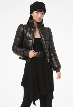 Black Plongé Leather Puffer Jacket Women's By Michael Kors. Women's Black Plongé Leather Cropped Puffer Jacket Michael Kors boasts puffed shoulders, front zip pockets and defining ribbed cuffs.     #Fashion #LookBook #OutfitOfTheDay #LookOfTheDay  #Fashionable #Fashionista #FashionStylist