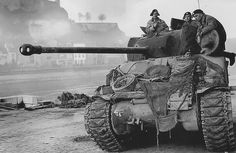 Sherman Firefly - British Mark V gun as used on the Sherman Firefly armed with the 17-lb anti-tank gun, near the bridge over the river Maas, in the city of Namur Belgium. December 1944. #worldwar2 #tanks