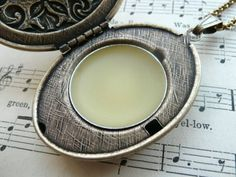 Smell Good, Naturally: How to Make Solid Perfume.  Ingredients   •Sweet Almond Oil or Olive Oil  •Beeswax (if you'd like to keep this vegan, use an equal amount of soy wax)  •Organic essential oils   Once you've decided on which fragrances you want to use, simply add equal parts of oil and wax together...continue info on blog